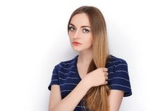 Beauty portrait of young adorable fresh looking blonde woman in blue t shirt. Emotion and facial expression concept. Royalty Free Stock Photos