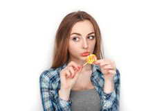 Beauty portrait of young adorable fresh looking blonde woman in blue plaid shirt posing candy lollipop. Emotion and facial express Stock Images