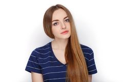 Beauty portrait of young adorable fresh looking blonde woman in blue t shirt. Emotion and facial expression concept. Royalty Free Stock Image