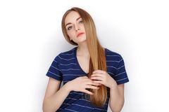 Beauty portrait of young adorable fresh looking blonde woman in blue t shirt. Emotion and facial expression concept. Royalty Free Stock Photography