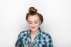Beauty portrait of young adorable fresh looking blonde woman with high bun hair chaos in blue plaid shirt. Emotion and facial expr Royalty Free Stock Photos