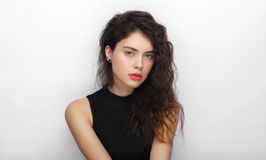 Beauty portrait of young adorable fresh looking brunette woman with long brown healthy curly hair. Emotion and facial expression l Stock Photography