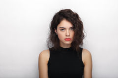 Beauty portrait of young adorable fresh looking brunette woman with long brown healthy curly hair. Emotion and facial expression l Stock Image