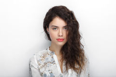 Beauty portrait of young adorable fresh looking brunette woman with long brown healthy curly hair. Emotion and facial expression l Royalty Free Stock Photo