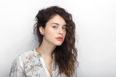 Beauty portrait of young adorable fresh looking brunette woman with long brown healthy curly hair. Emotion and facial expression l Royalty Free Stock Photos