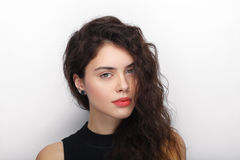 Beauty portrait of young adorable fresh looking brunette woman with long brown healthy curly hair. Emotion and facial expression l Stock Photos