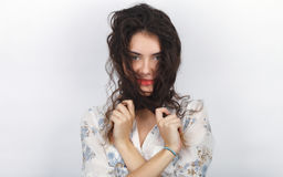 Beauty portrait of young adorable fresh looking brunette woman playing with her long brown healthy curly braided hair. Emotion and Royalty Free Stock Photography
