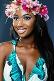 Beauty portrait of young african girl wearing flower garland. Stock Photography