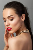 Beauty portrait of young aristocratic woman with red lips Royalty Free Stock Photo