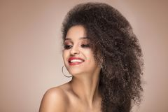 Beauty portrait of smiling sensual afro girl. Beauty portrait of young attractive african american woman with amazing toothy smile and glamour makeup Stock Photos