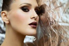 Beauty portrait of young attractive girl wearing makeup in studio stock photo