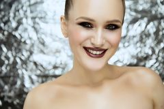 Beauty portrait of young attractive girl wearing makeup in studio royalty free stock photos