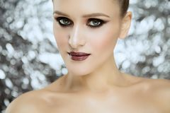 Beauty portrait of young attractive girl wearing makeup in studio royalty free stock photography