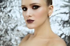 Beauty portrait of young attractive girl wearing makeup in studio stock images