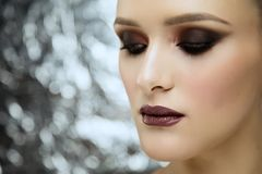 Beauty portrait of young attractive girl wearing makeup in studio stock photography