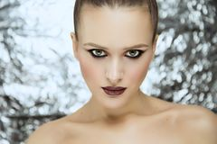 Beauty portrait of young attractive girl wearing makeup in studio royalty free stock images