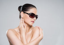 Beauty portrait of a young, attractive, healthy woman in sunglasses Stock Photos