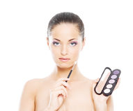 Beauty portrait of a young, attractive woman with a makeup pallet Stock Images