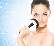 Beauty portrait of a young, attractive woman on the snow Stock Photography
