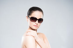 Beauty portrait of a young and attractive woman in sunglasses Stock Photo