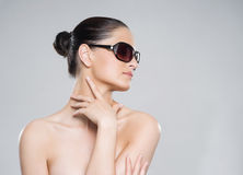 Beauty portrait of a young, attractive woman in sunglasses Stock Photography