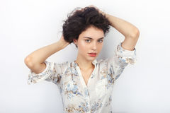 Beauty portrait of young beautiful cheerful young fresh looking woman with long brown healthy curly hair. Concept on white backgro Stock Images