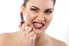 Beauty portrait of young beautiful woman with lipstick make grim Royalty Free Stock Image