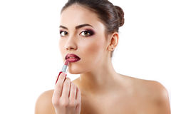Beauty portrait of young beautiful woman puts on lipstick on her Royalty Free Stock Photos