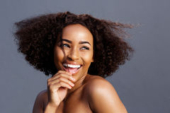 Beauty portrait of young black female fashion model laughing royalty free stock photos