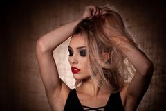 Beauty portrait of young blond caucasian woman over rae textile background royalty free stock photos