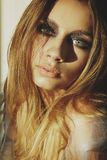 Beauty portrait of a young blond girl with smoky eyes makeup. Ar Royalty Free Stock Photos