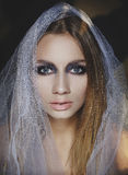 Beauty portrait of a young blond girl with smoky eyes makeup. Ar Stock Photography