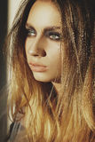 Beauty portrait of a young blond girl with smoky eyes makeup. Ar Royalty Free Stock Photo