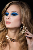 Beauty portrait of young blonde woman with blue smokey eyes make Royalty Free Stock Image