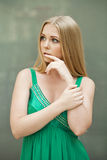 Beauty portrait of young blonde woman in green dress Stock Photos