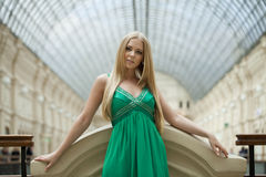 Beauty portrait of young blonde woman in green dress Royalty Free Stock Image