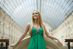 Beauty portrait of young blonde woman in green dress Stock Photography