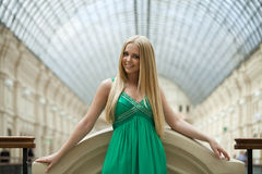 Beauty portrait of young blonde woman in green dress Stock Image