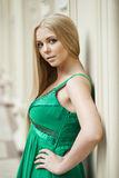 Beauty portrait of young blonde woman in green dress Stock Images