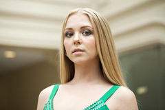 Beauty portrait of young blonde woman in green dress Royalty Free Stock Photo