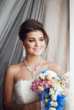 Beauty portrait of young bride holding bouquet. Perfect makeup a Royalty Free Stock Photography