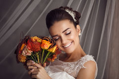 Beauty portrait of young bride. Perfect makeup and hairstyle. Royalty Free Stock Photos
