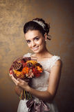 Beauty portrait of young bride. Perfect makeup and hairstyle. Stock Photos