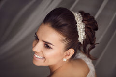 Beauty portrait of young bride. Perfect makeup and hairstyle. Royalty Free Stock Photo