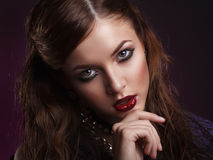 Beauty portrait of young brunette woman with creative makeup Royalty Free Stock Photos