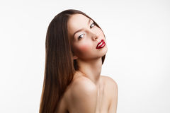 Beauty portrait of young brunette woman  with red lips on white Royalty Free Stock Photography