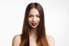 Beauty portrait of young brunette woman  with red lips on white Royalty Free Stock Photos
