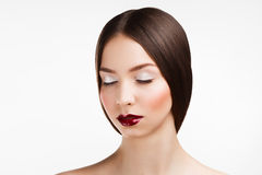 Beauty portrait of young brunette woman  with red lips on white Stock Photo
