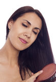 Beauty portrait of young caucasian woman with comb Royalty Free Stock Photos