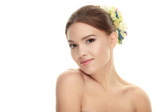 Beauty portrait of young cute brunette woman with adorable makeup slightly smile flower headpiece on white studio background Royalty Free Stock Images